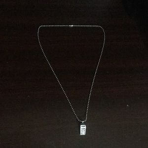 Necklace with a whistle